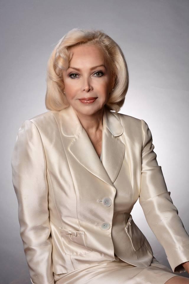 Irina in white suit